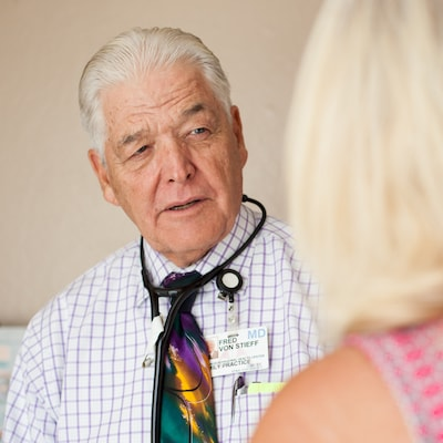 addiction medicine - Image of doctor speaking with woman